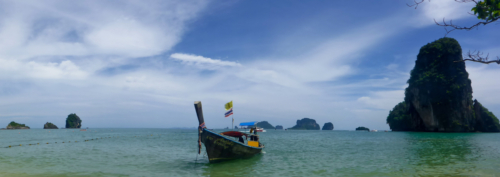 Exploring Krabi islands in a traditional Thai boat
